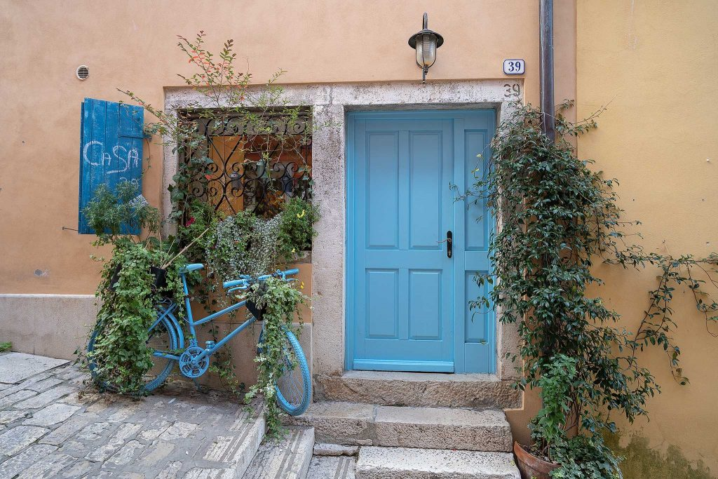Blue door and bicycle in Rovinj